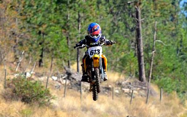 Young motocross rider performs on the big stage